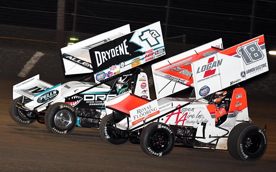 Gio Scelzi (18) battles Jacob Allen during Friday's World of Outlaws NOS Energy Drink Sprint Car Series feature at Volusia Speedway Park. (Frank Smith Photo)