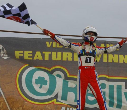 Buddy Kofoid celebrates his victory Saturday at Bubba Raceway Park. (Rich Forman Photo)