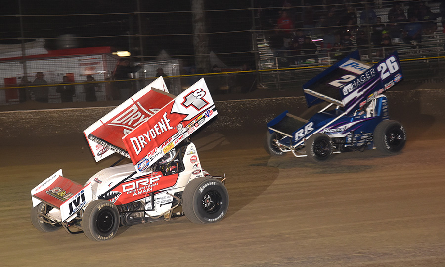 Logan Schuchart (1s) races ahead of Cory Eliason during Sunday's World of Outlaws NOS Energy Drink Sprint Car Series event at Volusia Speedway Park. (Paul Arch Photo)