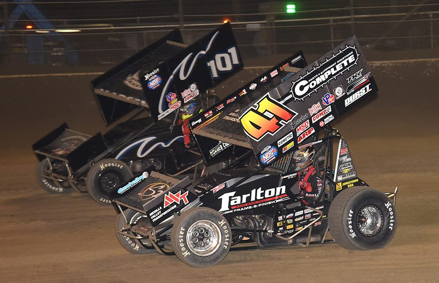 Carson Macedo (41) battles Kerry Madsen during Sunday's World of Outlaws NOS Energy Drink Sprint Car Series event at Volusia Speedway Park. (Paul Arch Photo)