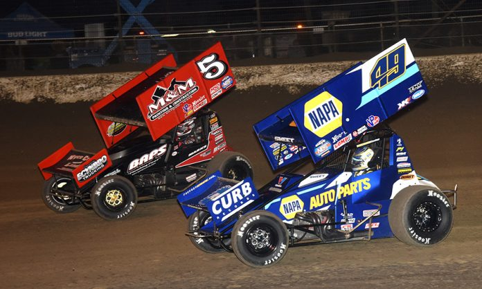 Brad Sweet (49) races under Brent Marks during Sunday's World of Outlaws NOS Energy Drink Sprint Car Series event at Volusia Speedway Park. (Paul Arch Photo)