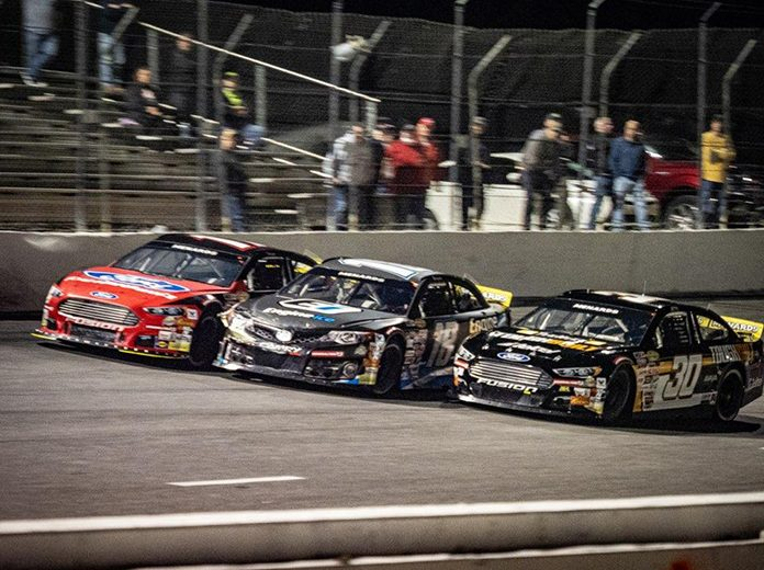 Max Gutiérrez (30) beat Sammy Smith (18) and Taylor Gray (17) to the checkered flag to win Monday's ARCA Menards Series East opener at New Smyrna Speedway. (Jason Reasin Photo)