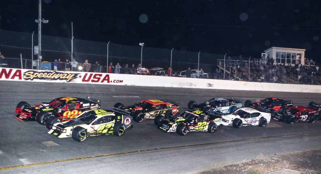 The field for Wednesday's John Blewett III Memorial 76 prepares to go racing at New Smyrna Speedway. (Dick Ayers Photo)