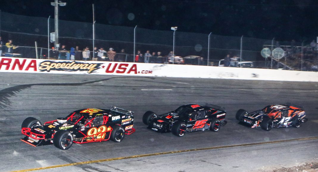 Anthony Nocella (92), Ron Silk (16) and Tommy Catalano race for position during the John Blewett III Memorial 76 Wednesday at New Smyrna Speedway. (Dick Ayers Photo)