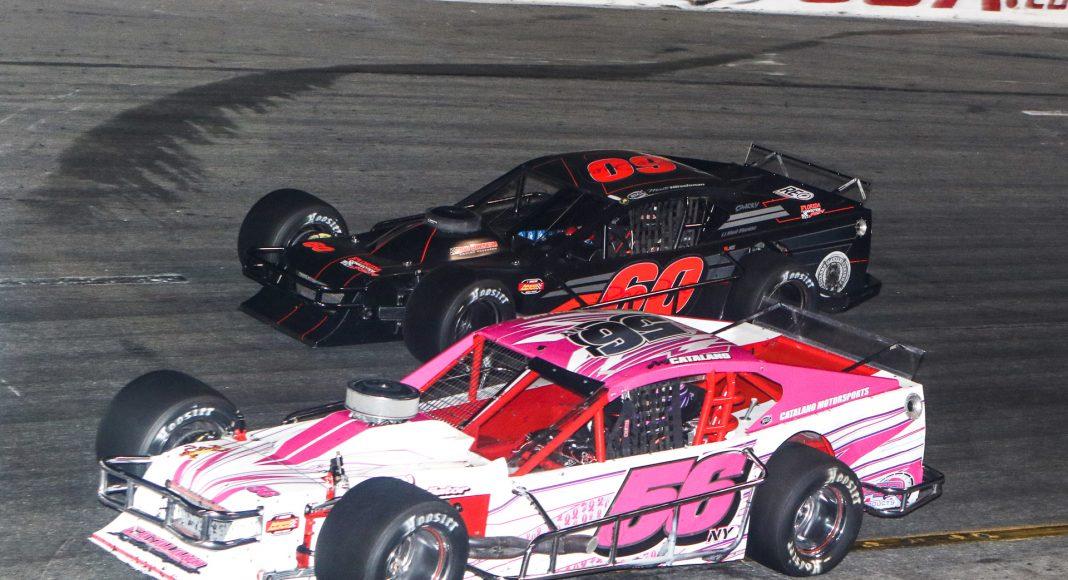 Amy Catalano (56) battles alongside Matt Hirschman during the John Blewett III Memorial 76 Wednesday at New Smyrna Speedway. (Dick Ayers Photo)
