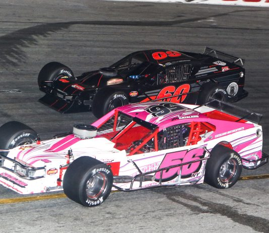 Amy Catalano (56) battles alongside Matt Hirschman during the John Blewett III Memorial 76 Wednesday at New Smyrna Speedway. (Dick Ayers Photo)