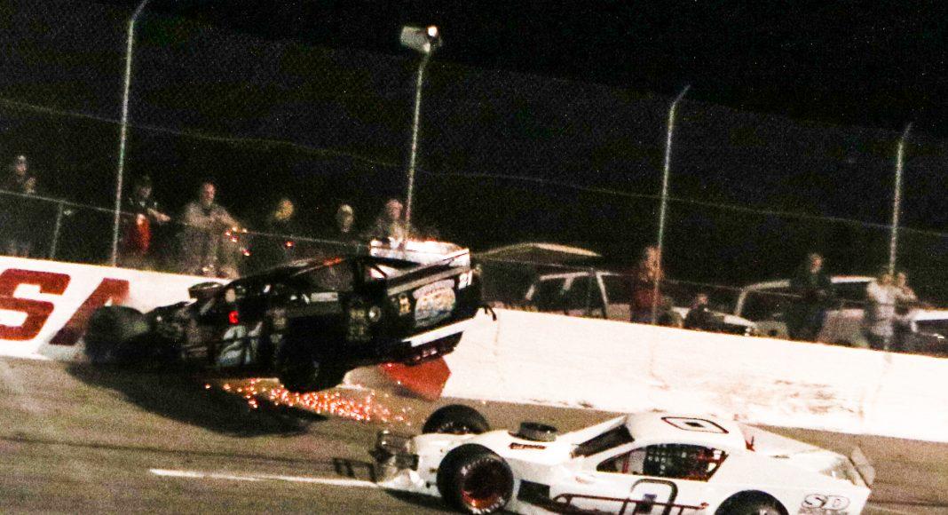 Jim Gavek (21) goes up in air during an incident as part of Wednesday's John Blewett III Memorial 76. (Dick Ayers Photo)