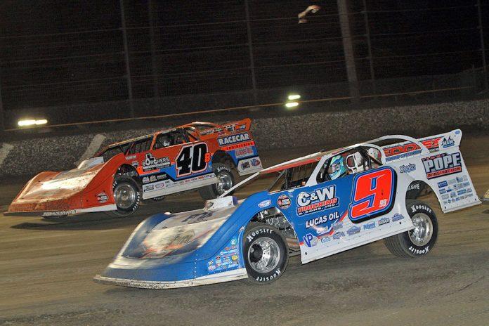 Devin Moran (9) races under Kyle Bronson at Volusia Speedway Park. (Jim DenHamer photo).