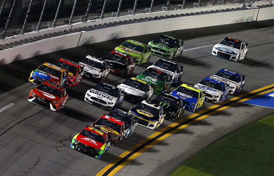 William Byron (24) leads the pack during Duel No. 2 on Thursday night at Daytona Int'l Speedway. (NASCAR/Getty Images Photo)