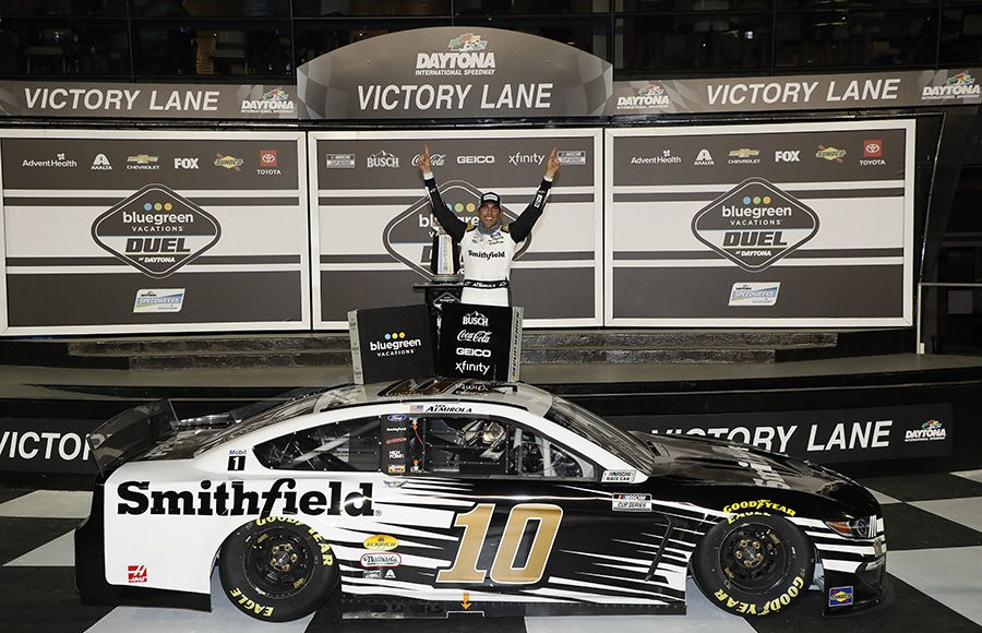 Aric Almirola celebrates in victory lane following his victory in Duel No. 1 Thursday at Daytona Int'l Speedway. (HHP/Harold Hinson Photo)