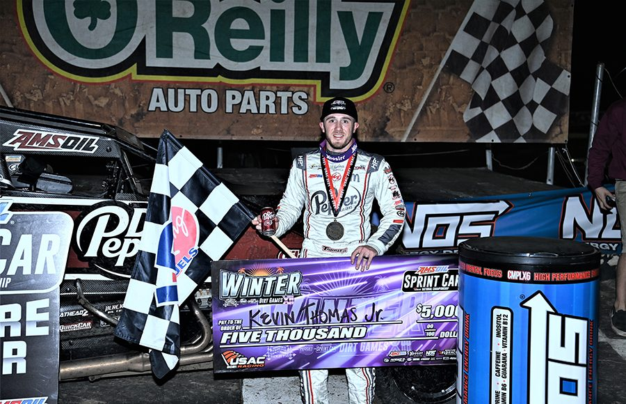 Kevin Thomas Jr. poses in victory lane following his victory Thursday at Bubba Raceway Park. (Al Steinberg Photo)