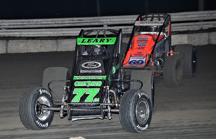C.J. Leary (77) races under Brady Bacon during Thursday's USAC AMSOIL National Sprint Car Series event at Bubba Raceway Park. (Al Steinberg Photo)