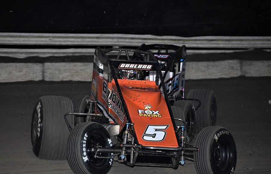 Dave Darland (5) slides under Sterling Cling during Thursday's USAC AMSOIL National Sprint Car Series event at Bubba Raceway Park. (Al Steinberg Photo)