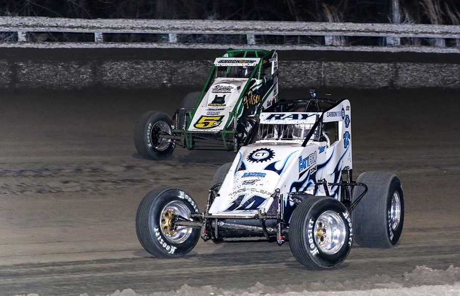 Davey Ray (14) battles Chase Stockon during Friday's USAC AMSOIL National Sprint Car Series event at Bubba Raceway Park. (Dick Ayers Photo)