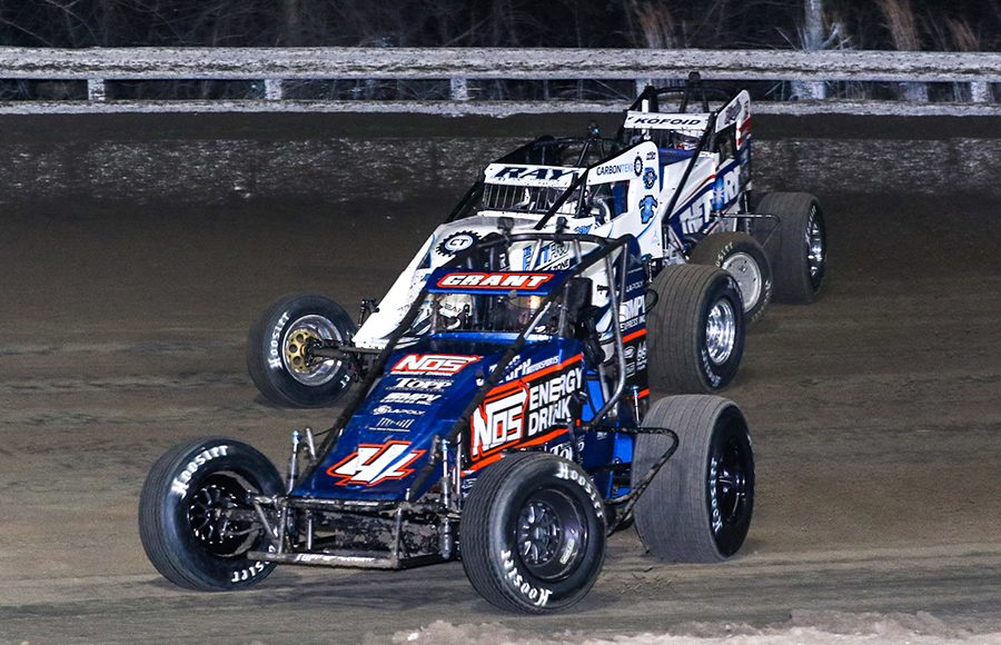 Justin Grant (4), Davey Ray (14) and Buddy Kofoid battle for position during Friday's USAC AMSOIL National Sprint Car Series event at Bubba Raceway Park. (Dick Ayers Photo)