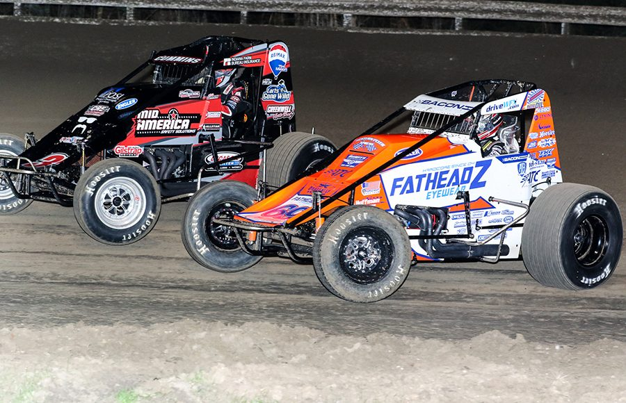 Brady Bacon (69) battles alongside Kyle Cummins during Friday's USAC AMSOIL National Sprint Car Series event at Bubba Raceway Park. (Dick Ayers Photo)