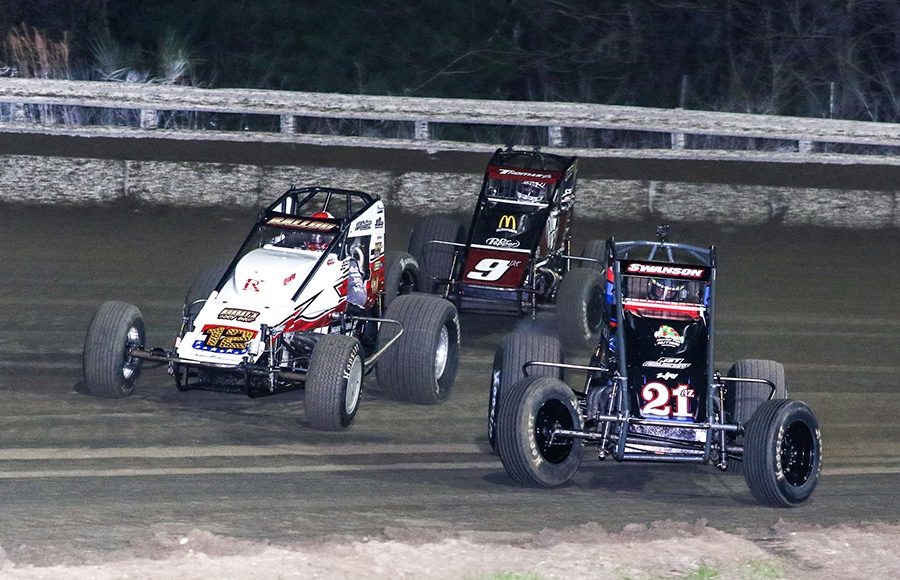 Jake Swanson (21AZ), Robert Ballou (12) and Kevin Thomas Jr. race during Friday's USAC AMSOIL National Sprint Car Series event at Bubba Raceway Park. (Dick Ayers Photo)