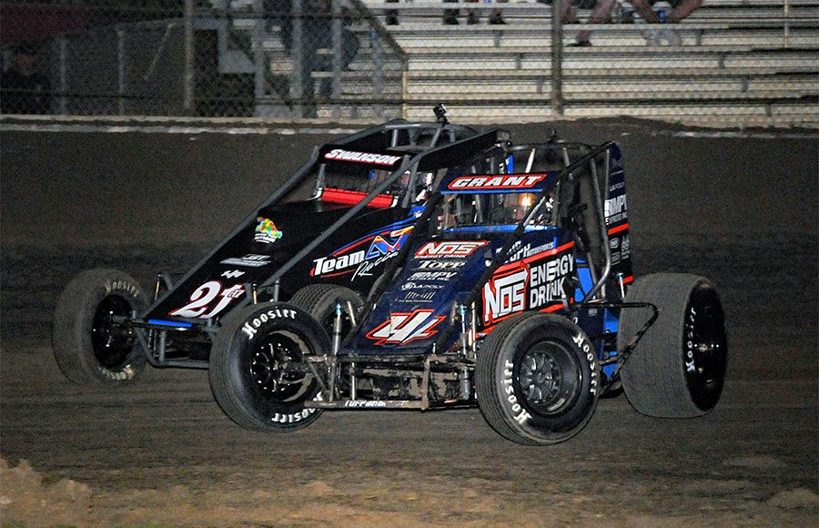 Justin Grant (4) races under Jake Swanson during Friday's USAC AMSOIL National Sprint Car Series event at Bubba Raceway Park. (The Wheatley Collection)