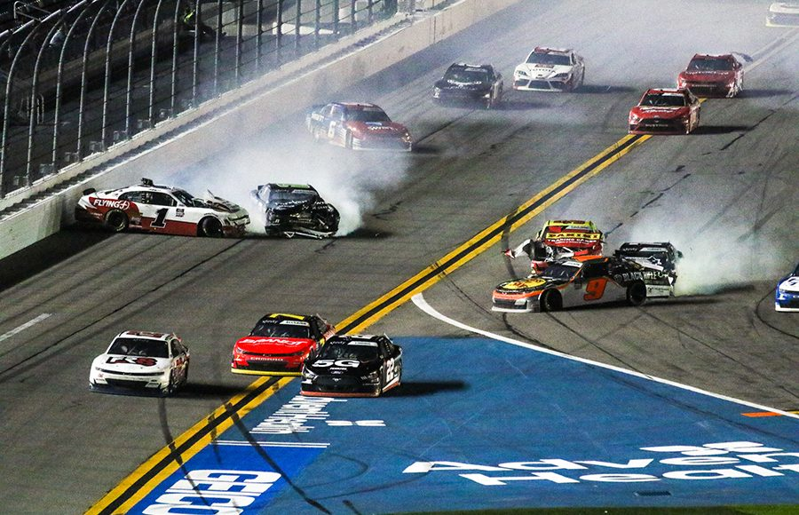 Competitors crash heading into the tri-oval during Saturday's NASCAR Xfinity Series opener at Daytona Int'l Speedway. (Dick Ayers Photo)