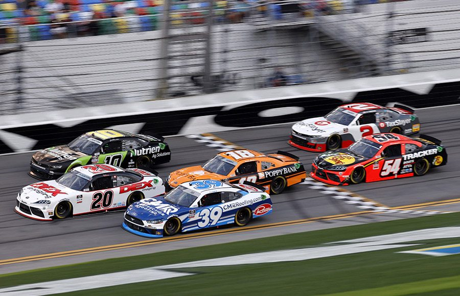Harrison Burton (20) noses ahead of a group of cars during Saturday's NASCAR Xfinity Series event at Daytona Int'l Speedway. (NASCAR/Getty Images Photo)