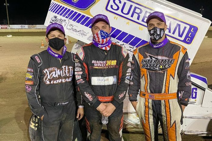 Justin Sanders (center) shares the podium with Wes Wofford and J.T. Imperial. (Ron Gilson photo)