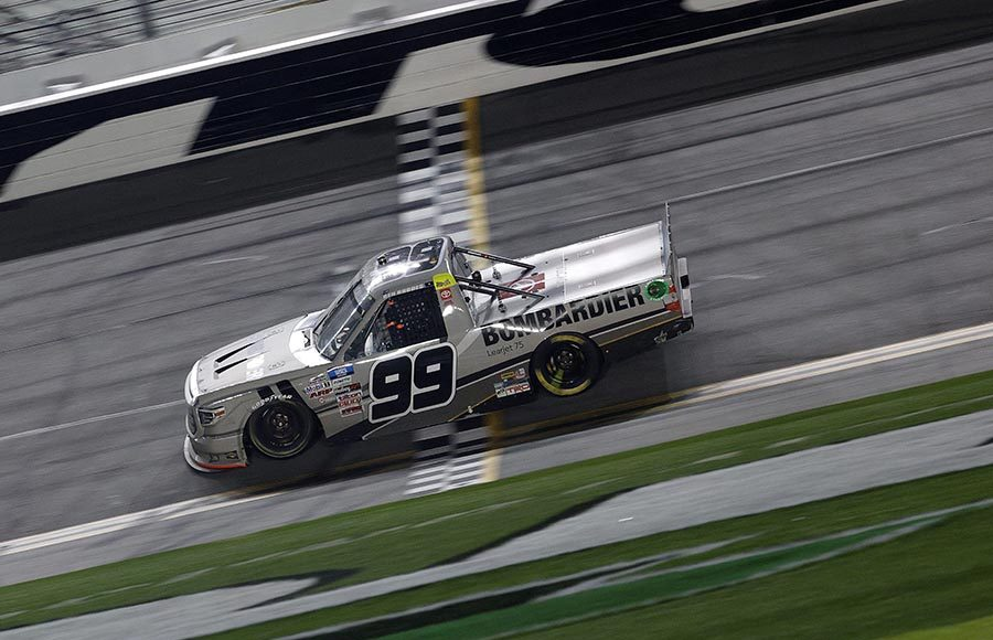 Ben Rhodes crosses the finish line to win Friday's NASCAR Camping World Truck Series race on the Daytona Road Course. (Photo by Chris Graythen/Getty Images)