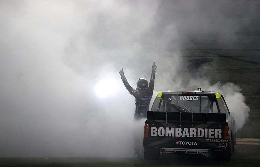 Ben Rhodes celebrates after winning Friday's NASCAR Camping World Truck Series event on the Daytona Road Course. (Photo by Chris Graythen/Getty Images)
