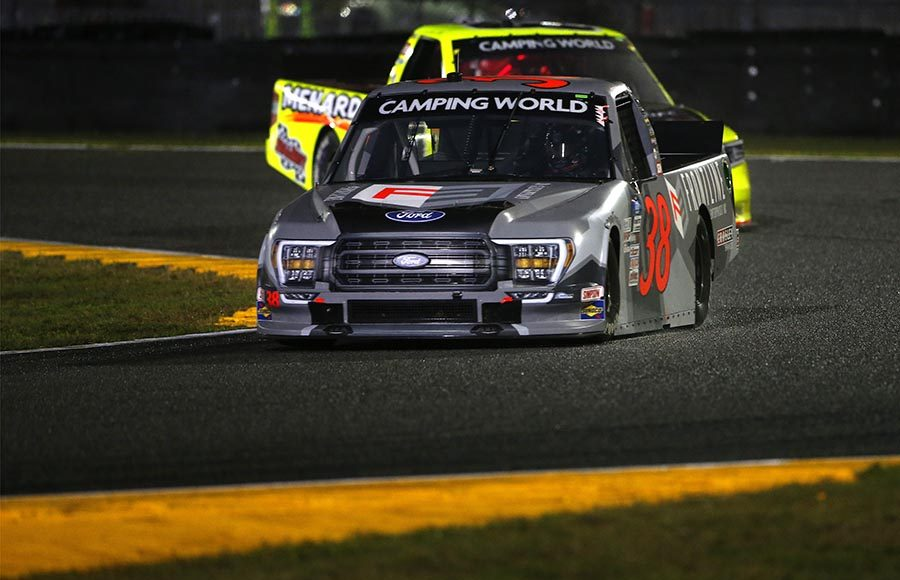 Todd Gilliland (38) races ahead of Matt Crafton during Friday's NASCAR Camping World Truck Series event on the Daytona Road Course. (Photo by Brian Lawdermilk/Getty Images)