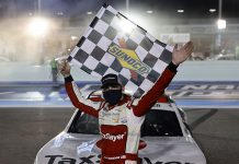 Myatt Snider poses with the checkered flag after winning his first NASCAR Xfinity Series race Saturday at Homestead-Miami Speedway. (Michael Reaves/Getty Images Photo)