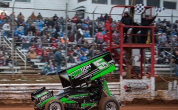 Tim Wagaman crosses the finish line to win the Ice Breaker Saturday at Lincoln Speedway. (Shawn Cooper Photo)