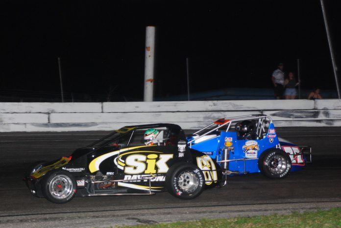 Kyle O'Gara (67) battles Kody Swanson at Showtime Speedway. (David Sink photo)