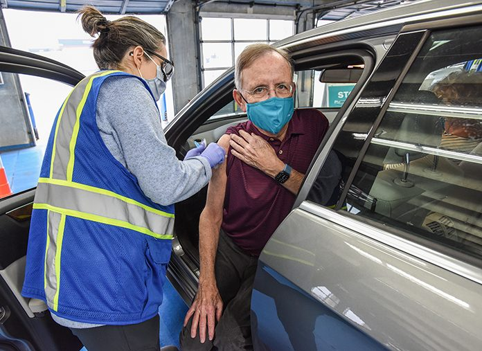 Jim Bolt receiving the COVID-19 vaccine during a mass vaccination clinic held at Charlotte Motor Speedway (sister track to New Hampshire Motor Speedway) on Feb. 11. (Emily Barnes Photo)