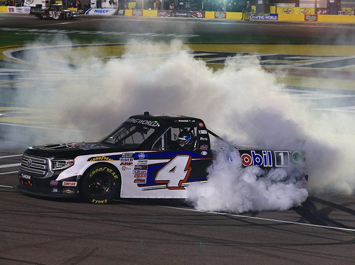 John Hunter Nemechek celebrates with a burnout after winning Friday's NASCAR Camping World Truck Series race. (HHP/Jim Fluharty Photo)