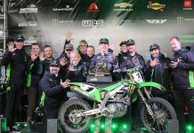 Eli Tomac poses in victory lane with his team after winning his fifth Daytona Supercross event.