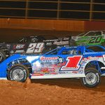 A three-wide battle between Brandon Sheppard (1), Darrell Lanigan (29), and Jimmy Owens (20) during Saturday's World of Outlaws Late Model Series feature at Smoky Mountain Speedway. (Michael Moats photo)