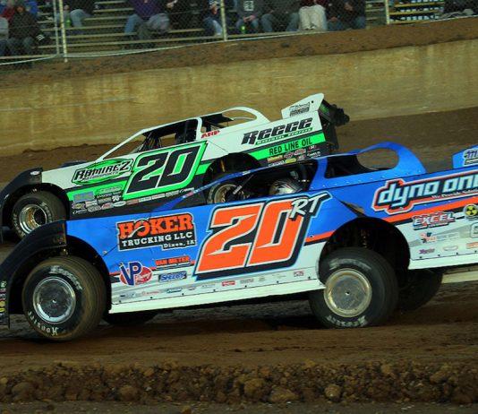 Ricky Thornton Jr. (20r) races under Jimmy Owens Saturday at Florence Speedway in Kentucky. (Jim DenHamer photo)