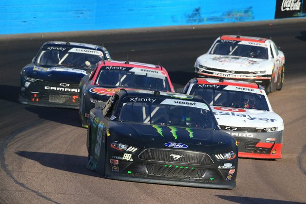 Riley Herbst (98) leads a pack of cars during Saturday's NASCAR Xfinity Series event at Phoenix Raceway. (HHP/Jim Fluharty Photo)