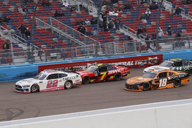 Austin Cindric (22) leads the way during a restart Saturday at Phoenix Raceway. (HHP/Harold Hinson Photo)