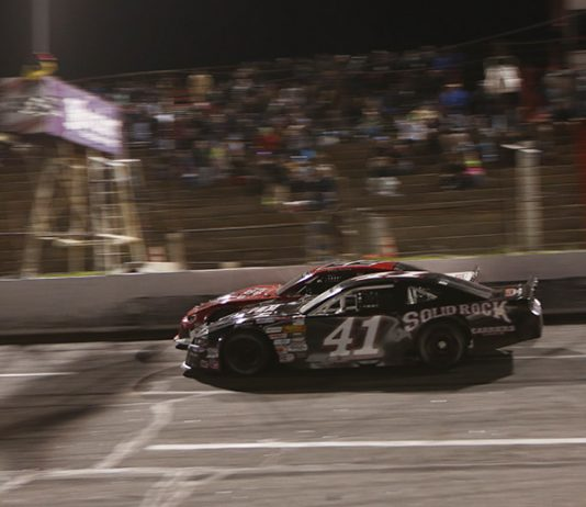 Tyler Mathews (41) races Bobby McCarty to the finish line Saturday at Hickory Motor Speedway. (Adam Fenwick Photo)