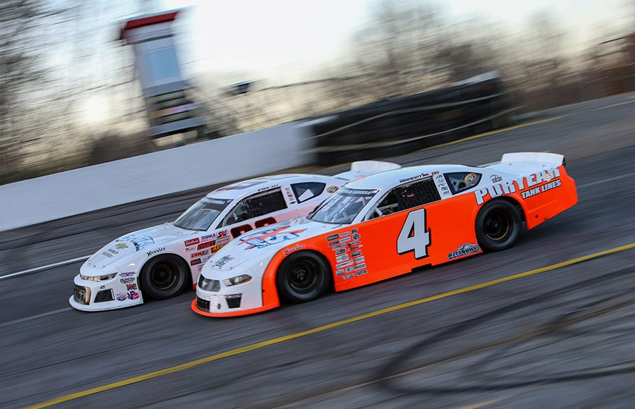 Kaden Honeycutt (4) races under William Cox III during Saturday's CARS Late Model Stock Tour event at Hickory Motor Speedway. (Adam Fenwick Photo)