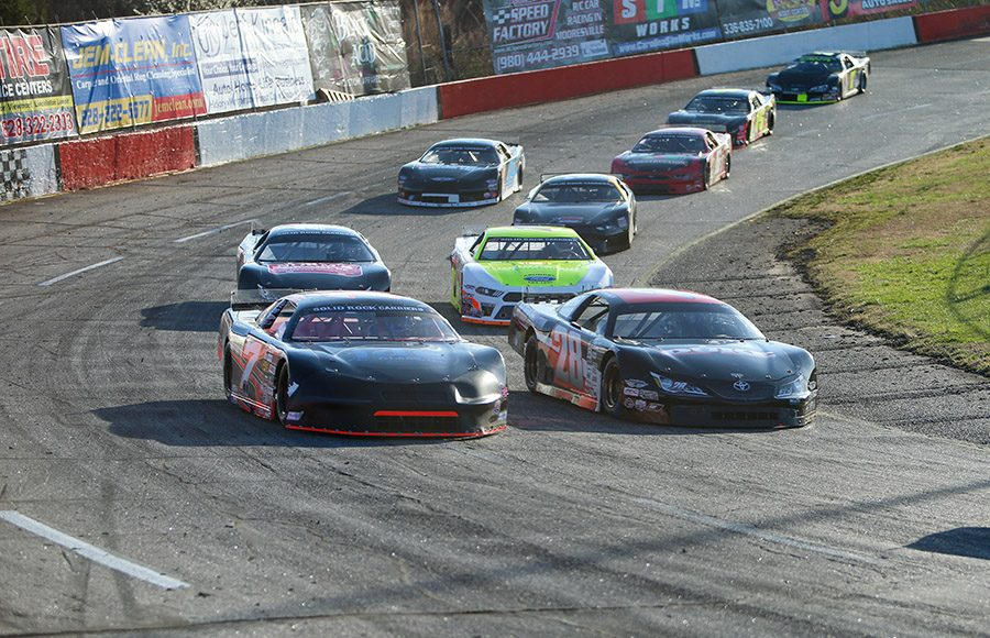 T.J. Duke (28) races alongside Justin Crider during Saturday's CARS Super Late Model Tour feature at Hickory Motor Speedway. (Adam Fenwick Photo)