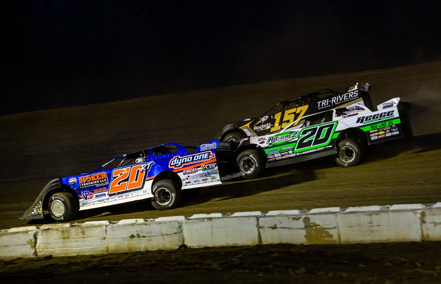 Ricky Thornton Jr. (20RT), Jimmy Owens (20) and Mike Marlar battle three-wide during Sunday's Lucas Oil Late Model Dirt Series race at Atomic Speedway. (Heath Lawson Photo)