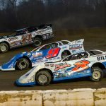 Kyle Strickler (8), Devin Moran (9) and Hudson O'Neal battle three-wide during Sunday's Lucas Oil Late Model Dirt Series event at Atomic Speedway. (Heath Lawson Photo)