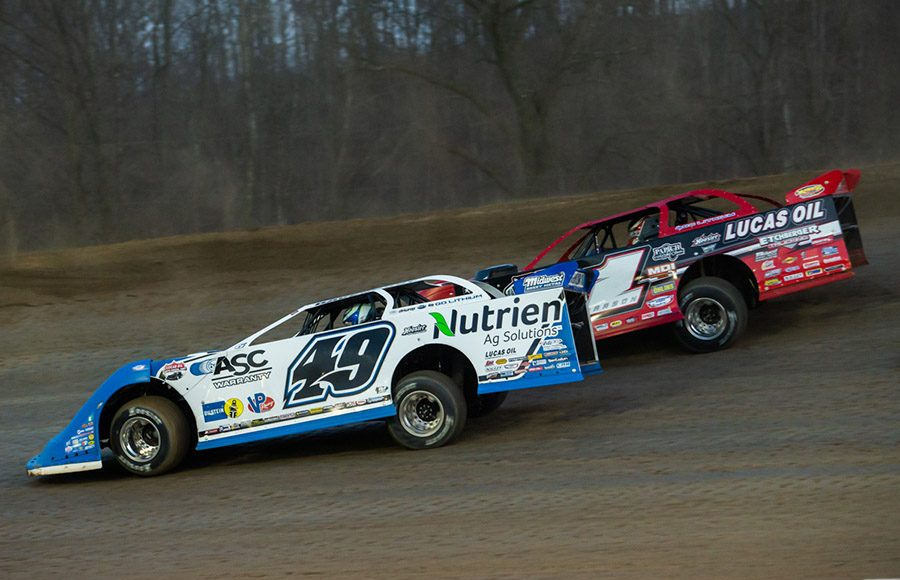 Jonathan Davenport (49) races alongside Earl Pearson Jr. during Sunday's Lucas Oil Late Model Dirt Series event at Atomic Speedway. (Heath Lawson Photo)