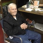 Art Boune at his desk at the ART Enterprises office.