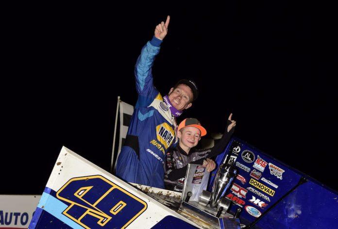 Brad Sweet and Jaxx Johnson celebrate after Sweet won Saturday's Jason Johnson Classic. (Mark Funderburk photo)