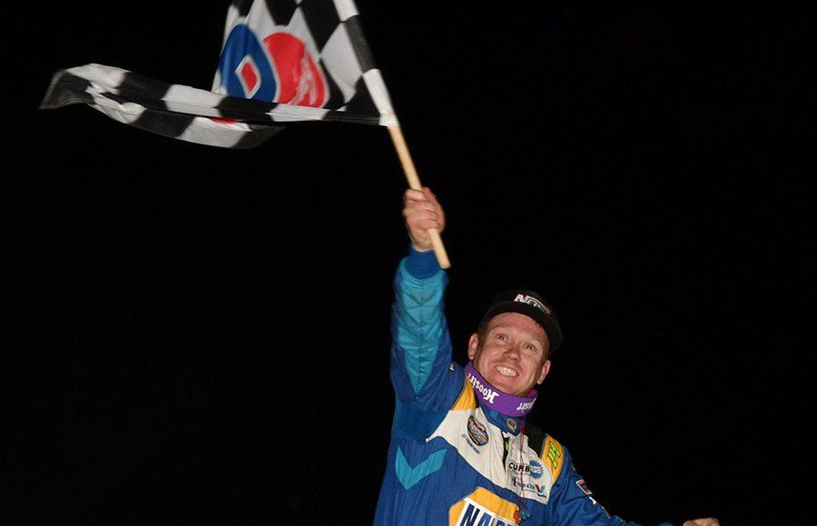 Brad Sweet celebrates after winning the Jason Johnson Classic Saturday at Lake Ozark Speedway. (Ken Simon Photo)