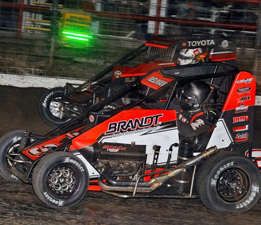 Jake Neuman (3N) races under Cannon McIntosh Sunday night at Port City Raceway. (The Wheatley Collection Photo)