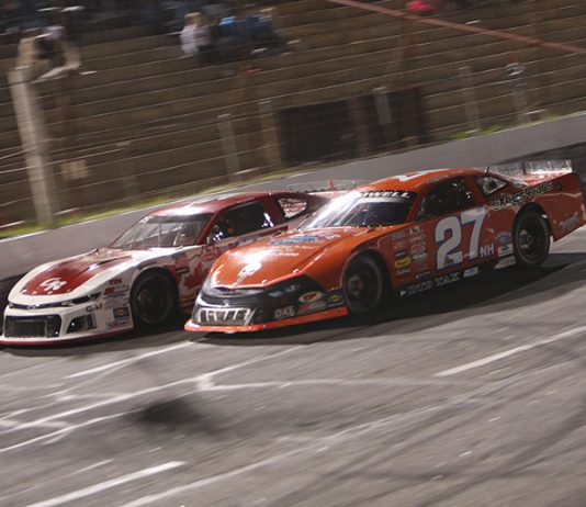Wayne Helliwell Jr. (27) races under Mike Hopkins Friday at Hickory Motor Speedway. (Adam Fenwick Photo)