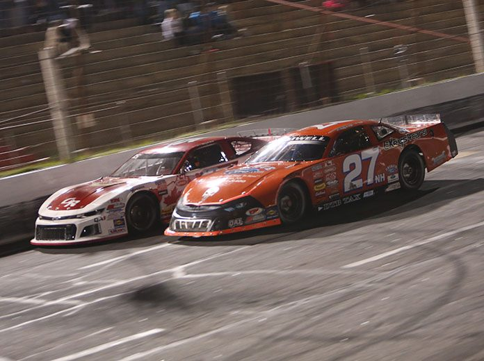 Wayne Helliwell Jr. (27) races under Mike Hopkins Friday at Hickory Motor Speedway. (Adam Fenwick Photo)
